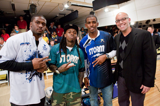 Reggie Bush, Lil Wayne, Chris Paul and Tom Clark, the PBA Vice President and Chief Operating Officer, pose while attending the 2010 Chris Paul Celebrity Bowling Invitational in New Orleans.