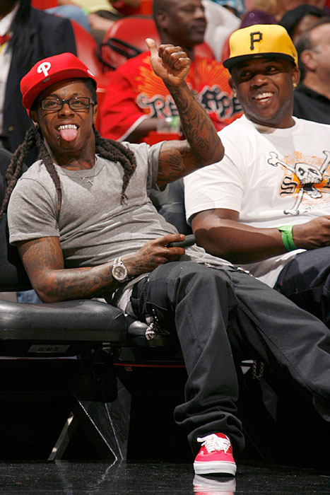 Wayne is all smiles during a 2009 Heat-Thunder game in Miami.