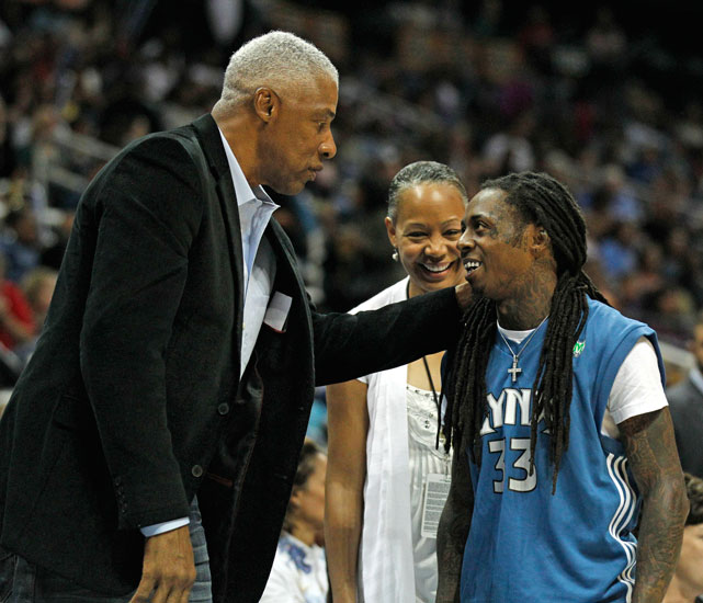 Lil Wayne is greeted by the good Doctor (J) during Game 3 of the 2009 WNBA Finals.