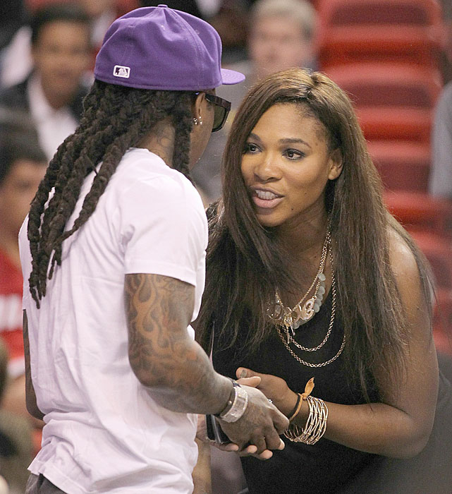 Tennis star Serena Williams talks with Wayne during a 2010 Heat-Pistons game in Miami.