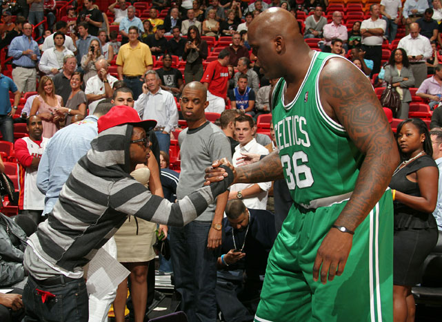 Shaquille O'Neal, who has released five rap albums himself, gives props to Lil Wayne during a 2010 Celtics-Heat game in Miami.