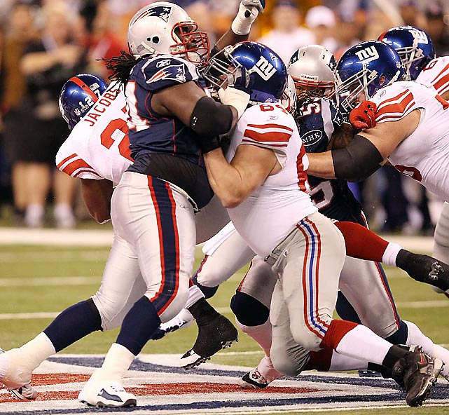 The Giants opened some running holes for their backs by driving back Vince Wilfork.