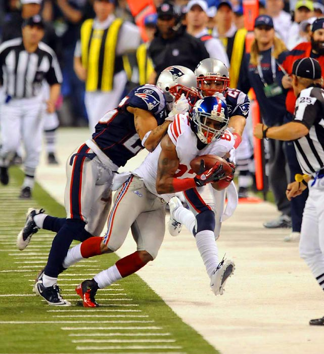 Manningham got both feet down and maintained possession of the ball.