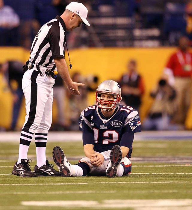A game official offers Brady a hand after a play that didn't go the Patriots way.