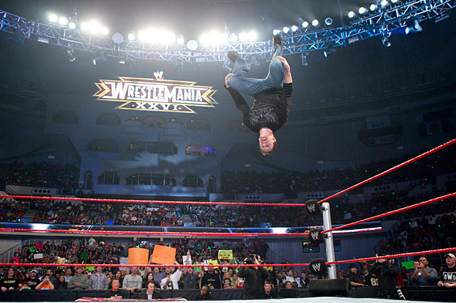 NASCAR driver Carl Edwards shows off his athletic ability during a Feb. 2010 episode of WWE's Monday Night Raw.