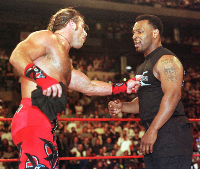 "In one of the most publicized appearances in WWE history, Iron Mike Tyson served as guest enforcer for the WrestleMania XIV main event between ""Stone Cold"" Steve Austin and Shawn Michaels. Tyson counted the 1-2-3 on Michaels and then gave ""The Heartbreak Kid"" a knockout punch after he confronted him for making the pinfall. ""Iron"" Mike will be inducted into the WWE Hall of Fame next month."
