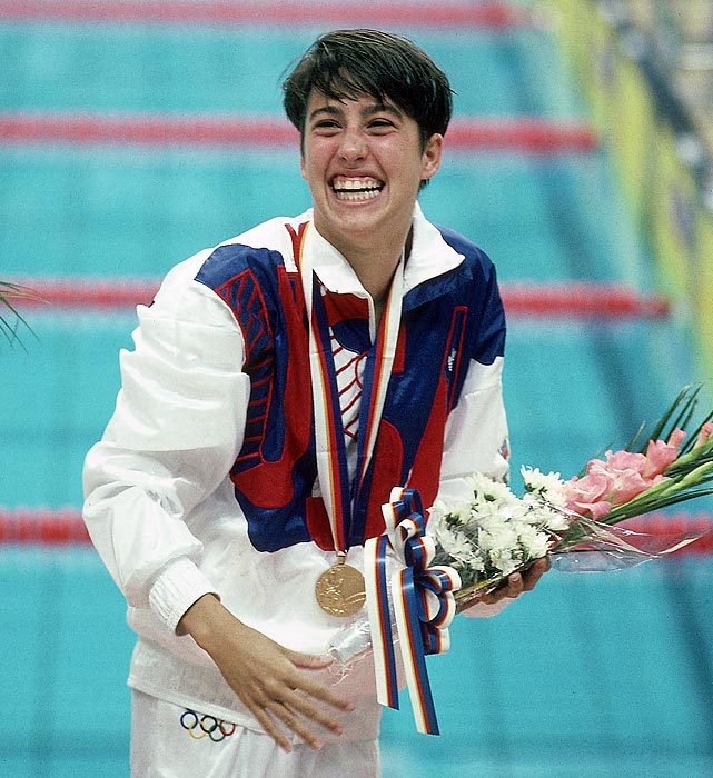 Evans, then just 17, smiles after winning one of her three gold medals at the 1988 Olympics.