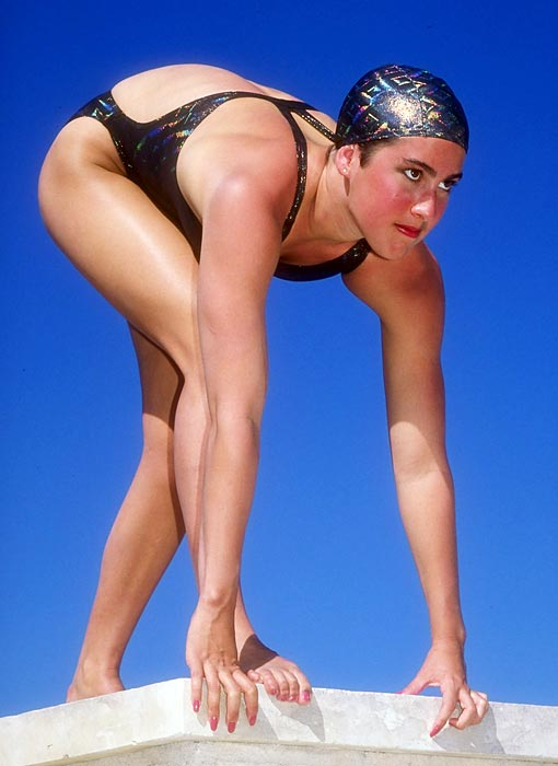 Evans prepares to jump into an Austin, Texas pool in 1991. In addition to her four Olympic golds, Evans was a five-time winner at the World Championships.