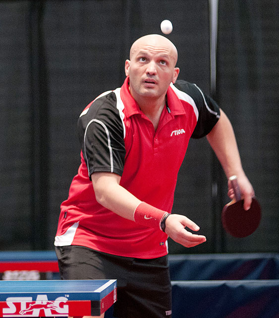Razvan Cretu tracks the ball through the air before serving on the last day of the table tennis trials. Cretu, who calls Forth Worth, Texas home, finished ninth overall.