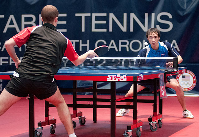 Timothy Wang (right) hovers above the table before he laces a return in his match against Chance Friend on Feb. 12. Wang, who finished 8-3, was the last male to qualify for the North American trials.