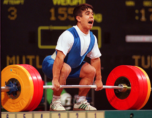 Mutlu took the baton from the Pocket Hercules and won three straight golds of his own from 1996 to 2004. Like his Turkish predecessor, Mutlu doesn't crack 5 feet. But he does own the oldest Olympic weightlifting records in the books, all coming at the 2000 Games in the lightest division (56 kilograms).