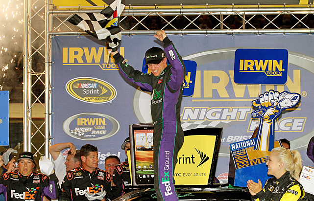 Denny Hamlin won for the first time at Bristol Motor Speedway with a calculated late pass. Hamlin flirted with Carl Edwards for the lead late in the race, and set up his move with 39 laps remaining Saturday night. Hamlin used a slide move to get past Edwards, then held on as Edwards tried to use a cross-over move to get back in front. Jimmie Johnson finished second and clinched a berth in the Chase for the Sprint Cup championship. Greg Biffle and Dale Earnhardt Jr. also locked down spots in the 12-driver field.