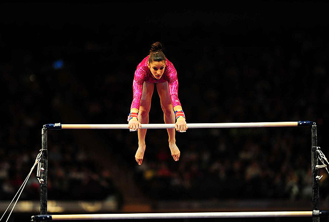 Alexandra Raisman competes in the uneven bars. She earned a 14.333, the second-best score of the day behind Jordyn Wieber's 14.833.