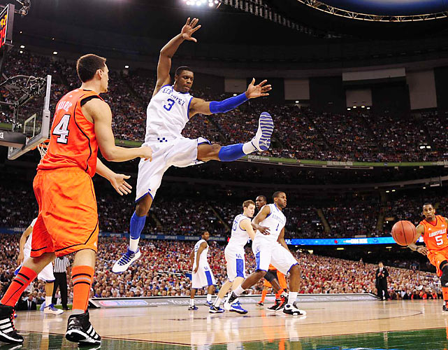 Kentucky's Terrence Jones tries to deflect a Louisville inbounds pass. The Wildcats turned on the defense in the Final Four, holding the Cardinals to 34.8 percent shooting.