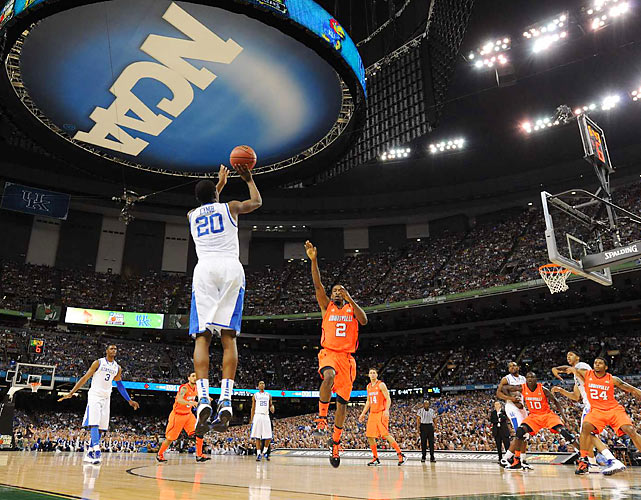 Doron Lamb (20) launches a 3-pointer for Kentucky. The Wildcats move on to play for the program's eight national championship.