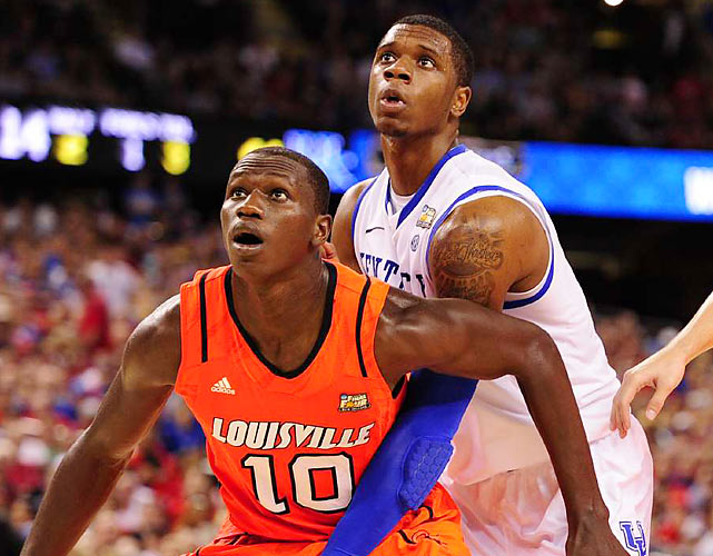 Louisville's Gorgui Dieng boxes out Kentucky's Terrence Jones. Dieng was a force for the Cardinals in the post, grabbing 12 rebounds on the evening -- including eight offensive boards.