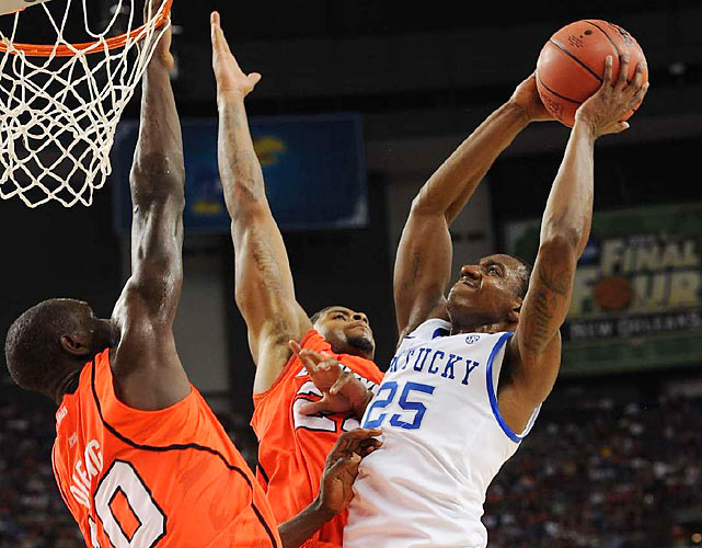 Louisville's Gorgui Dieng (left) and Chase Behanan (center) alter the shot of Kentucky's Marquis Teague. Dieng registered all four of the Cardinals' blocks on Saturday night.