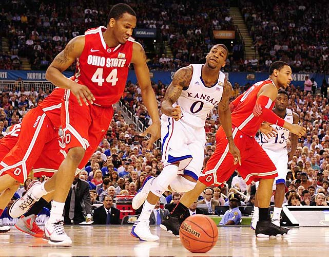 Ohio State's William Buford (44) starts the Buckeye fast break alongside Thomas Robinson (0) of Kansas. Buford led Ohio State's offense with 19 points on the night.