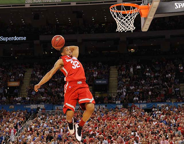 Lenzelle Smith Jr. of Ohio State breaks free for an uncontested dunk against Kansas. Smith and the Buckeyes broke out to a 13-point lead early but succumbed to the Jayhawks late.