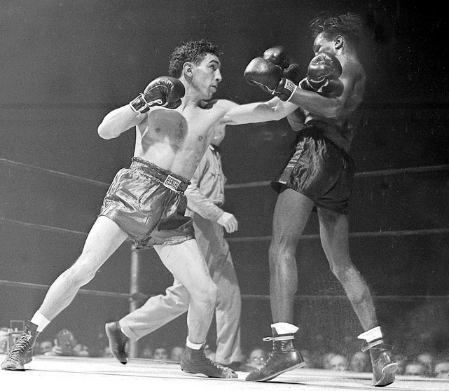 Featherweight champion 1942-48 and 1949-50. Pro record: 230 wins, 65 KOs, 11 losses, one draw.