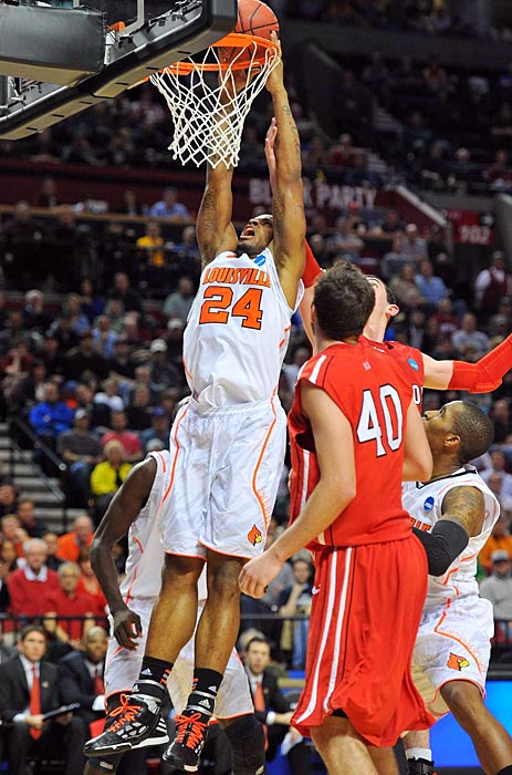 Louisville's Chane Behanan slams down a dunk. Behanan had a standout game for the Cardinals, scoring 14 points and pulling down 11 boards