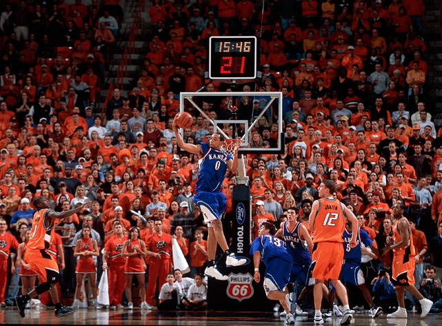 Drew Gooden snags a rebound in a 2002 game at Oklahoma State. Gooden teamed up with classmates Nick Collison and Kirk Hinrich to lead the Jayhawks to the 2002 and 2003 Final Fours.