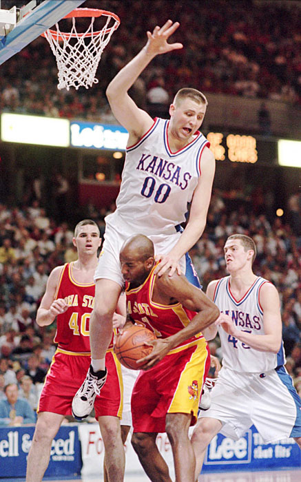 Center Greg Ostertag fouls an Iowa State player during a 1995 game. Ostertag 75a20582e