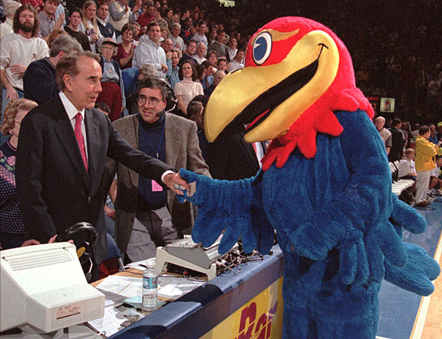 Former Kansas Senator Bob Dole shakes hands - or should it be shakes wings? -- with the Jayhawks mascot in this 1998 photo.