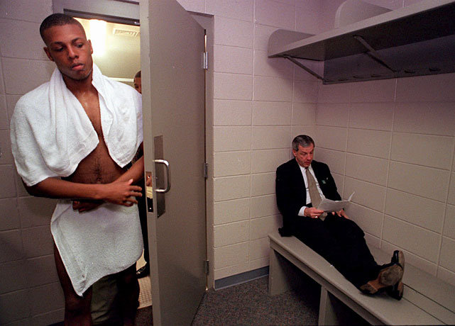 Paul Pierce comes out of the shower as coach Roy Williams sits dejectedly in the corner of the locker room after Kansas lost 85-82 to Arizona in the 1997 Sweet Sixteen. Pierce's No. 34 is retired by Kansas.