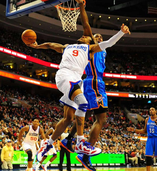 Philadelphia's Andre Iguodala attempts an acrobatic layup against Oklahoma City's Serge Ibaka.