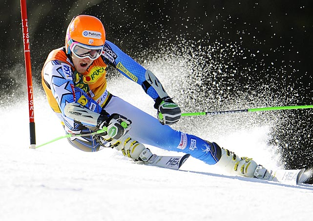 Olympic gold medalist Ted Ligety powers past a gate during the first run of the World Cup Giant Slalom competition in Slovenia.