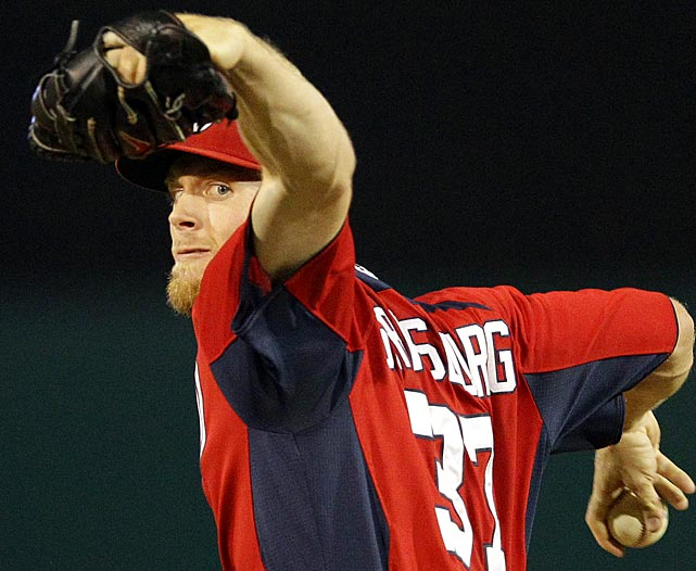 Washington Nationals pitcher Stephen Strasburg throws while warming up between innings during a Spring Training game against the Miami Marlins. Strasburg, the No. 1 pick in the 2009 draft, is trying to comeback from Tommy John surgery undergone in 2010.
