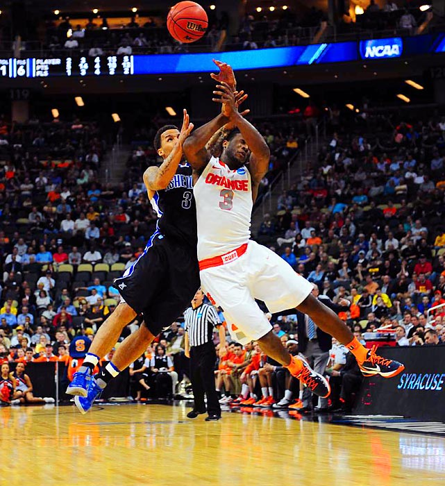 Syracuse's Dion Waiters collides with UNC Asheville's J.P. Primm during their second round game in the NCAA tournament. The Bulldogs gave 'Cuse a run for their money, but the no.1 seed held on for the win, 72-65.