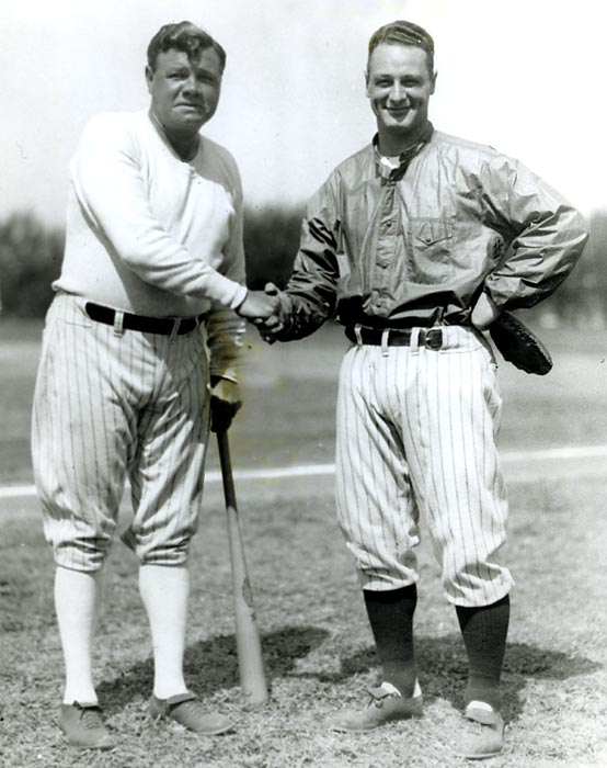 Ruth and Lou Gehrig pose while attending Yankees training camp in St. Petersburgh, Fla.