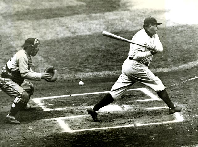 Babe Ruth swings and misses during a 1934 Dodgers-Yankees game. Ruth retired with a lifetime batting average of .342.