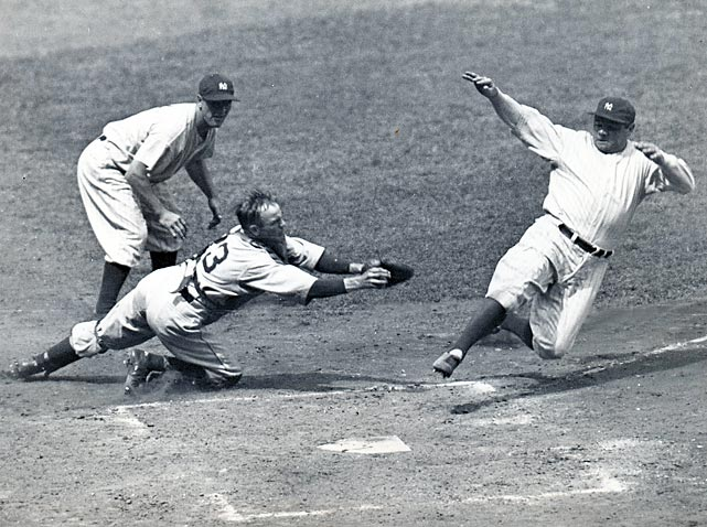 Ruth slides safely into home during a 1934 Yankees-Tigers game.