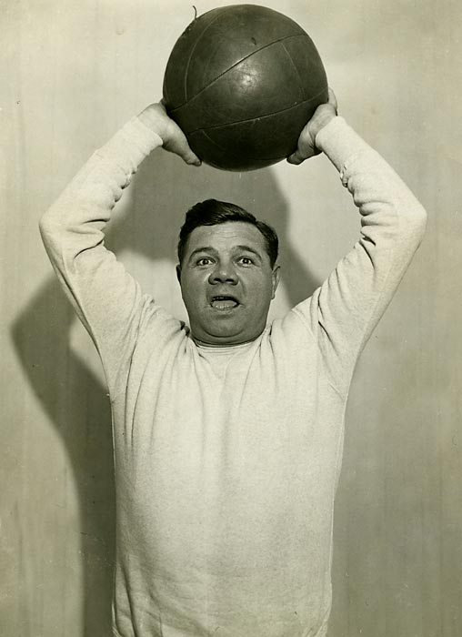Babe Ruth hoists a medicine ball at McGoverns Gym in New York City.