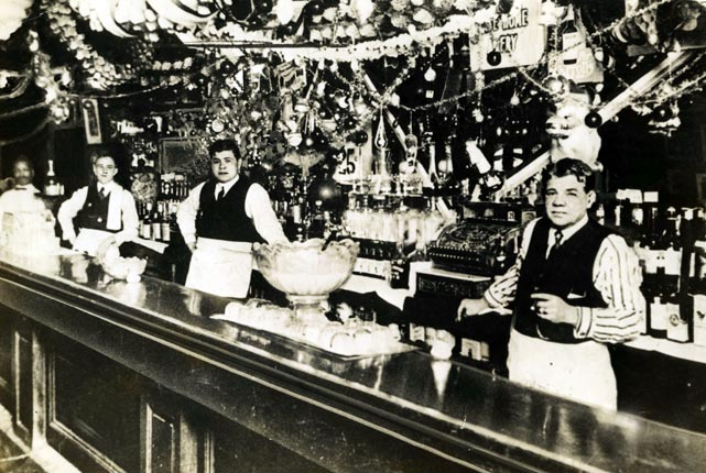 Babe Ruth (center) with his father, George Herman Ruth Sr, tend bar in Baltimore. The elder Ruth owned several saloons in the Baltimore area.