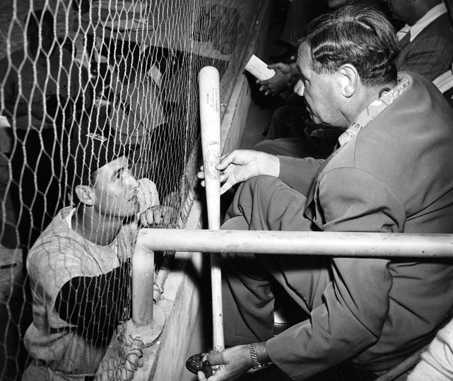 Ted Williams receives some hitting advice from Ruth during a spring training game.