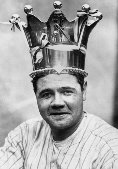 """Ruth is crowned the """"King of Swat by manager Miller Huggins, who gives him a ceremonial crown worth $600."""