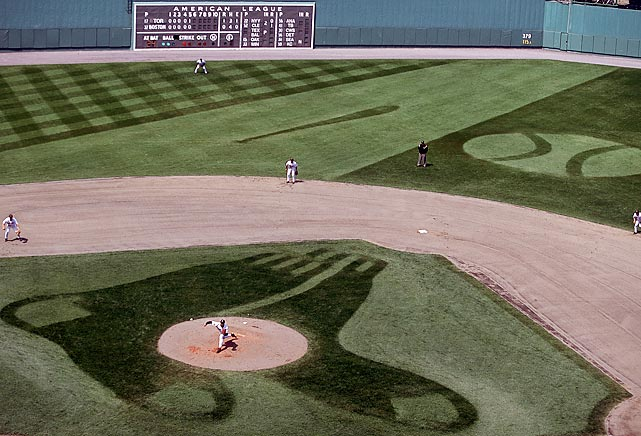 The grass at Fenway Park is mowed to resemble the Red Sox logo for a 2001 game against Toronto.