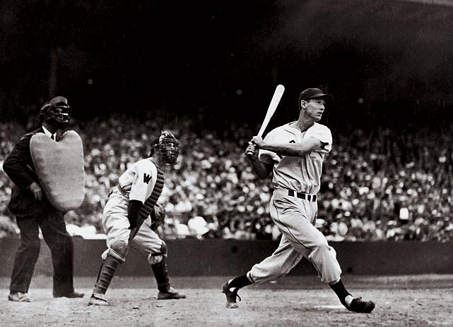 Ted Williams connects with a ball during a 1941 game against Washington. Williams remains one of Boston's all-time most popular players. He retired in 1960 with a .344 batting average.
