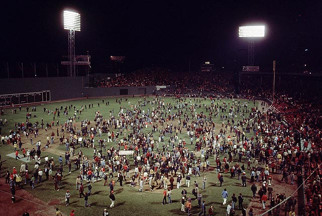 Red Sox fans walk on the Fenway Park grass after Game 7 of the 1975 World Series. Boston lost in seven games.