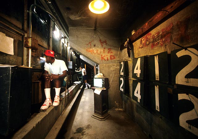 The inside of the Green Monster is a part of Fenway Park many fans never get to visit. In this 1987 photo, a worker watches a game against the Yankees.
