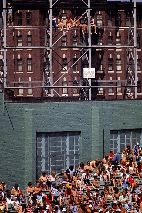 Red Sox fans in the stands and sitting on scaffolding during a 1975 game against the Tigers.