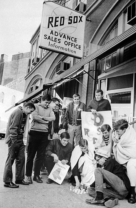 Red Sox fans bundle up and play chess while waiting in line for tickets to the 1967 World Series.