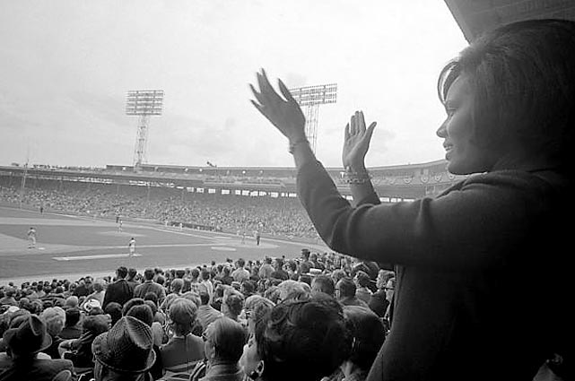 Bob Gibson's wife applauds as her husband pitches in the first inning of a  1967  World Series game at Fenway.