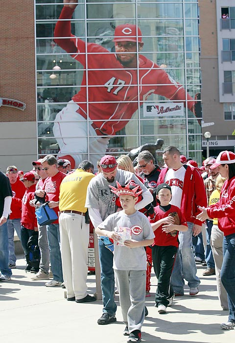 Cincinnati Reds fans file into Great American Ball Park for their home opening day game against the Miami Marlins in their National League MLB baseball game in Cincinnati, Ohio, April 5, 2012.