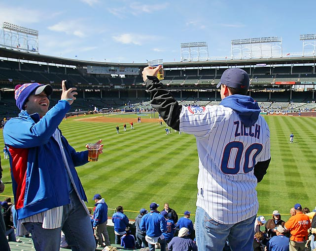Fans of the Chicago Cubs take photos during batting practice in the right field bleachers before the opening day game against the Washington Nationals at Wrigley Field on April 5, 2012 in Chicago, Illinois.