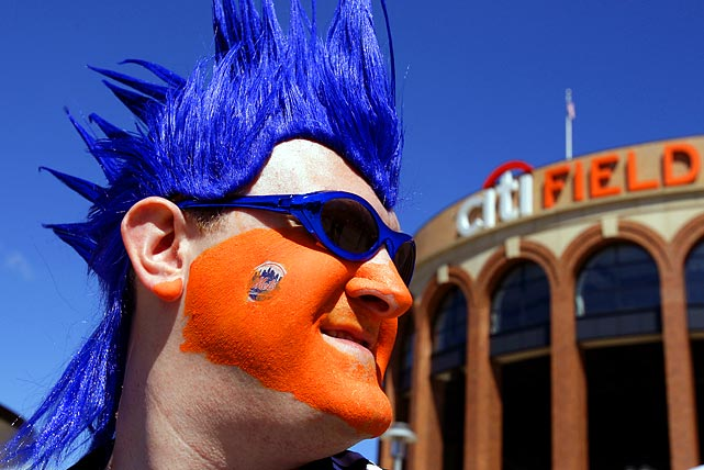 Mets fan with painted faces stood outside the stadium before New York's game against the Braves.